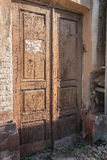 Old Wood Door. In a building ruined Stock Photography