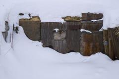 Old Wood Door Buried in the Snow. Stock Photo