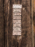 Old Wood Door Detail with Plates on It Stock Photo