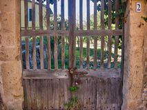 Old wood door entrance in cute old house stock images