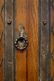 An old wood door handle knocker for print Royalty Free Stock Images