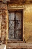 Old Wood Door India Rough Wall royalty free stock photo