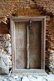 Old Wood Door India falling brick Wall Royalty Free Stock Images