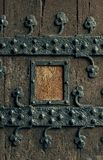 Old wood door with ornament. Old wood door with iron-shod decorative ornament. Place for text in frame stock images