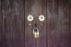 Old wood door and key lock Stock Photos