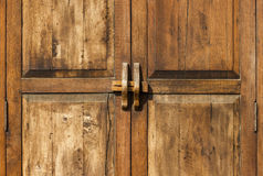 Old wood door with lock in Thailand Stock Photography