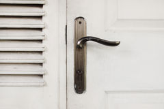 Old wood door with metal handle Stock Photos