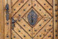 Old wood door. With metal handle Stock Photos