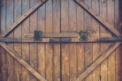 Old wood door with metal handle Stock Image