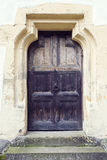 Old wood door with metal knob in Prejmer fortified church, Braso Stock Photo