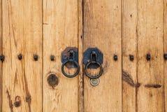 Old wood door with metal rings Royalty Free Stock Image