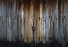 Old wood door. Natural old grunge wooden door closed with key lock Royalty Free Stock Images