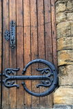 Old wood door with ornate hardware and handle Royalty Free Stock Photo