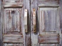 Old wood door. Old pale brown wooden door Stock Photos