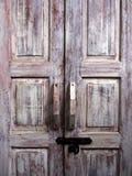 Old wood door. Old pale brown wooden door Stock Photo