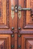 Old wood door on Peles museum, Sinaia Romania.  stock photo