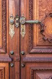 Old wood door on Peles museum, Sinaia Romania.  stock images