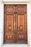 Old wood door on Peles museum, Sinaia Romania Royalty Free Stock Photos
