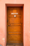Old Wood Door in Pink Stucco Building Stock Photography