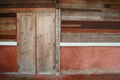 Old wood door and plank wall Royalty Free Stock Images