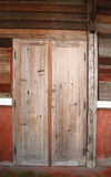 Old wood door and plank wall Stock Photo