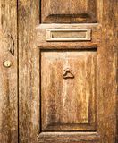 Old wood door with postbox Stock Photo