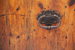 Old wood door with rusty handle Stock Images