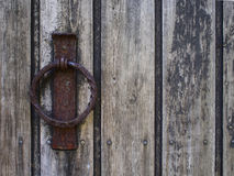 Old wood door with rusty ring Royalty Free Stock Photography