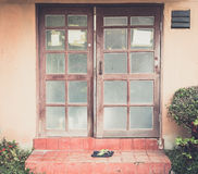 Old wood door with shoe Royalty Free Stock Images