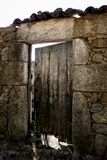 Old wood door on a stone building royalty free stock image