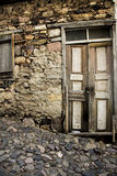 Old wood door and stone road Stock Photo