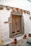 Old wood door in stone wall Stock Image