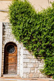 Old Wood Door in Stone Wall Royalty Free Stock Image