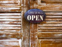 Old wood door with welcome sign.  Royalty Free Stock Image