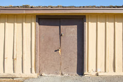 Old wood door with wooden wall. And blue sky Stock Images