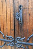 Old wood doors with ornate black hardware Royalty Free Stock Photos