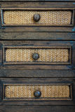 Drawer. Old wood drawer with bamboo weave patterns royalty free stock photography