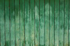Old wood fence background. Old green wood grunge fence background vertical Stock Photo