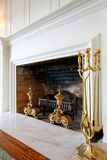 Old wood fireplace with white mental. Stock Photo