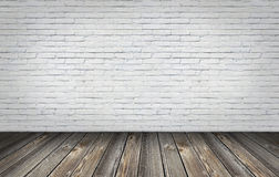 Old wood floor with white bricks wall Royalty Free Stock Photos