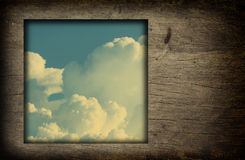 Old wood frame with blue sky white clouds  image Royalty Free Stock Image