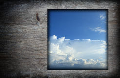 Old wood frame with blue sky white clouds  image Stock Image