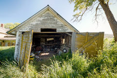 Old wood garage with wide load sign in it Royalty Free Stock Photography