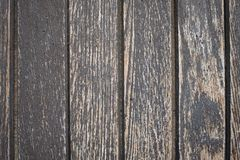 Old wood with grain and flaked of colour. At a door Stock Images