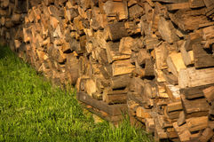 Old wood on green grass Royalty Free Stock Image