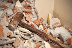 Old wood hammer on broken brick wall Royalty Free Stock Photos
