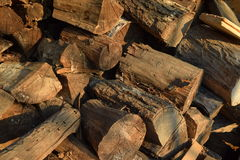 Old wood for heating. A pile of old wood for heating. Dark wood on top of each other royalty free stock photos