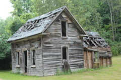 Old wood home. Old neglected wood home. Holes in roofs,no windows or doors. Will not withstand another winter Royalty Free Stock Photos