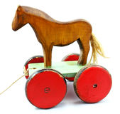 Old wood horse on wheels. Old wooden toy horse on wheels Royalty Free Stock Photo