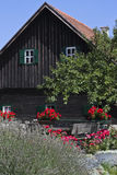 Old wood house with flowers Royalty Free Stock Image